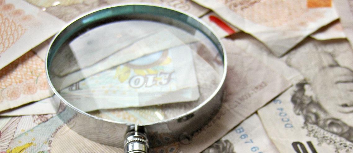 UK pounds magnifying glass credit taxrebate.org.uk cropped