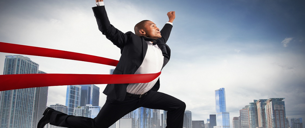 Sucess - Businessman Crossing Finish Line cropped