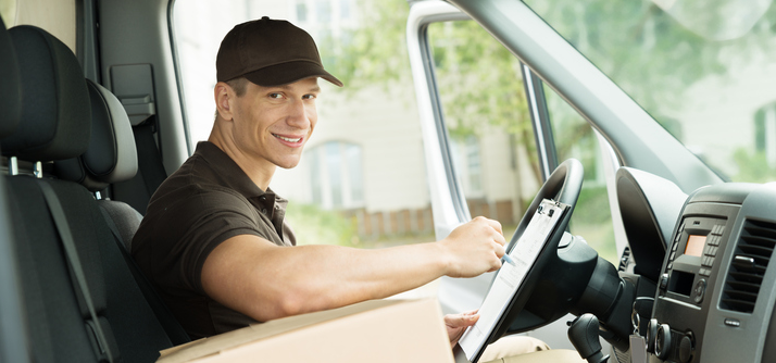 Smiling delivery guy in vehicle