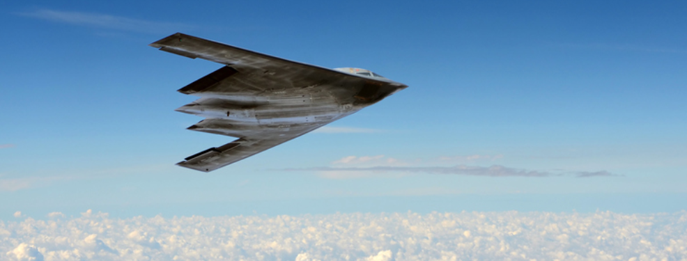 Image a stealth bomber over clouds